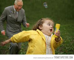 I have no idea what she has in her hand, but Prince Charles is ALL in