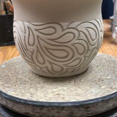 I've been experimenting with carving larger paisley designs and sketching out my idea first onto the pottery (that has white underglaze…