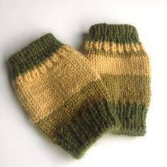 These fingerless mittens or wrist warmers were hand knit with the softest of wool and alpaca yarn. The golden yellow and olive green stripes are bold yet neutral. Wear anywhere with anything.