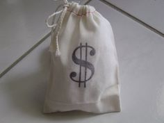 """10 money Bags muslin draw string Sacks. Too pricey but I could draw the """"dollar sign"""" onto little paper sacks"""