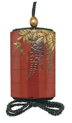 A Four-Case Inro Signed Koma Yasutada saku, Edo Period (19th century). Decorated in gold and black hiramaki-e and gold and silver foil on a red ground with wisteria