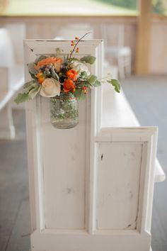 Flowers in mason jars on a church pew- LOVE! // photo by http://www.twilasphotography.com, see more: http://theeverylastdetail.com/orange-cornflower-blue-tennessee-wedding/