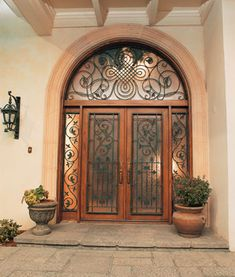 Hand Wrought Iron Door by Pinecrest – the Manorgate fine door collection:Beautifully elegant wrought iron doors, the Manorgate collection creates a fanciful yet sophisticated entrance. Pinecrest fine doors will grace castles, high-end homes and cottages as they create a stunning entrance way. The dark hand wrought iron over sparkling shining glass is framed by fabulous natural woods like Mahogany, Red Oak, Soft Maple and Alder. Swirling and twisting filigree adds a lovely texture and…