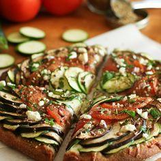 eggplant, zucchini, and tomato pizza
