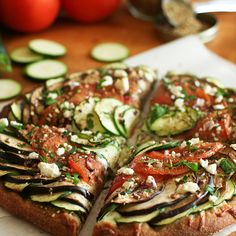 eggplant, zucchini, and tomato pizza