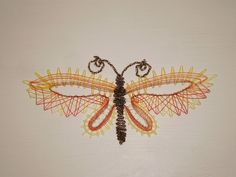 un papillon tout en dentelle aux fuseaux