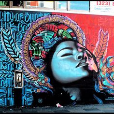 """This is located on Hollywood and Western in LA. The background is done by Retna and the woman is done by Elmac"""