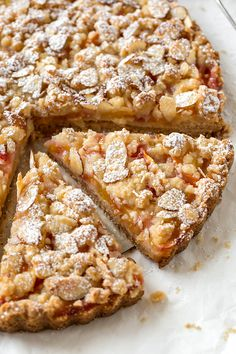 This juicy nectarine crumb tart is both sweet and tangy with a rich, buttery crust and crumbly topping—perfect with a scoop of vanilla ice cream! | thecozyapron.com #nectarinedesserts #nectarinerecipes #nectarinecrumble #nectarinecrumblerecipe #nectarinecrumbtart