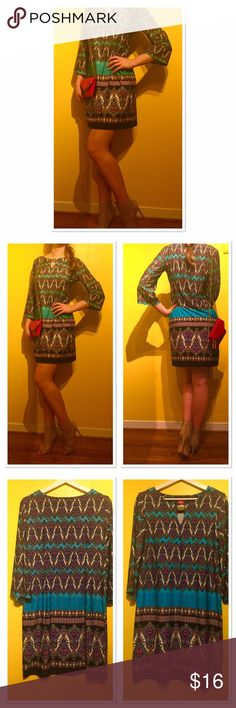 """Moroccan print turquoise ethnic tunic dress This dress has a Moroccan inspired pattern which stands out with its originality and interesting details. Vibrant turquoise color mixed with purple black and white. This tunic has 3/4 length sleeves and a golden broach.  It gives an exotic, well-travelled beauty feel. Worn once, excellent condition.  Measurements (approximately): Chest (pit to pit) 20"""" Waist: 36"""" Length:36"""" Sunny Leigh Dresses Mini"""