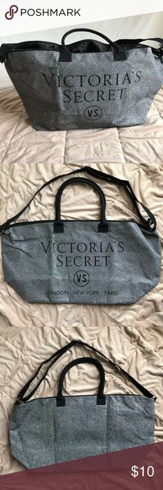 """NEW VS Weekender Bag w/shoulder strap - Sparkly! New, Never Used Victoria Secret Weekender Bag with handles and adjustable carry straps in black nylon. The bag is Silver and Sparkles with the Victoria's Secret name, logo and store locations (London, New York, Paris) printed on the outside. The measurements are 8"""" deep, 20"""" wide, 14"""" high. Use it for the weekend, a baby bag, gym or knocking around! Thank you for looking! :) PINK Victoria's Secret Bags Travel Bags"""
