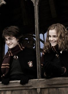 Harry and Hermione in Gryffindor uniforms