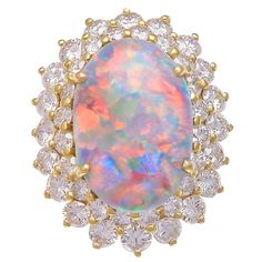 Cabochon Natural Opal Diamond Gold Ring | From a unique collection of vintage cocktail rings at https://www.1stdibs.com/jewelry/rings/cocktail-rings/