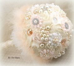 ***Made Upon Request- This brooch pearl bouquet is available in ANY color combination. This romantic and exquisite Sol Bijou brooch jeweled bouquet has been crafted with only handmade chiffon rosettes in a ivory and a very light shade of peach. This heirloom piece is soft, elegant and with