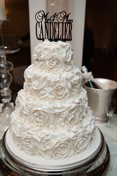 Ask your baker for sugar-made rosettes throughout your entire cake to replicate this entrancing look.