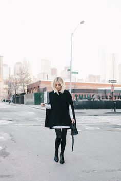 Damsel in Dior | DKNY Cape; Acne Studios Tunic Dress; Baby Sac du Jour; Matte Tights; Acne Studios Jensen Boots