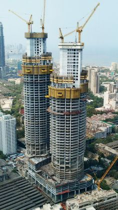 """Luxury apartments with sea view: In Worli to the south of Mumbai (India) , three luxury residential towers known as """"Omkar are currently under construction. A total of three Liebherr luffing jib cranes are working on the site! Crane Construction, Crawler Crane, Diecast Models, Burj Khalifa, Luxury Apartments, Willis Tower, Steel, Architecture, Building"""