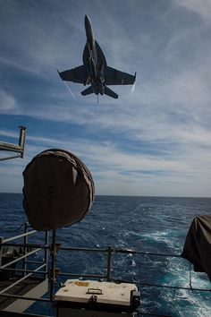An F/A-18F Super Hornet, assigned to the Flying Eagles of Strike Fighter Squadron (VFA) 122, prepares to land on the flight deck of the aircraft carrier USS Theodore Roosevelt (CVN 71).