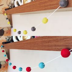 A personal favourite from my Etsy shop https://www.etsy.com/uk/listing/450061386/felt-ball-garland-pom-pom-red-and-blue