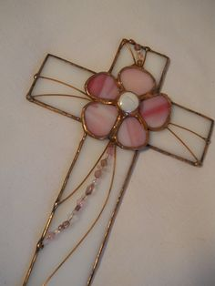 White Cross with Peach Flowers    The peach flowers were fashioned after the beautiful dogwood flowers. I draw the designs myself and each cross is decorated individually. The flowers are cut from a peach glass and are placed on a white glass cross that measures approximately 10 1/4 X 6 5/8. It hangs easily from a small, secure nail or picture hook. Although the petals were all cut from the same panel of glass there are subtle differences in each one.   For yourself as a wall decora...