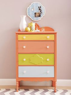 Citrus hues give this highboy a color-block update! Find more ways to update your furniture here: http://www.bhg.com/decorating/makeovers/furniture/before-and-after-furniture-makeovers/?socsrc=bhgpin121814vibranthues&page=20