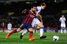 Martin Montoya of FC Barcelona duels for the ball with Inigo Martinez of Real Sociedad de Futbol during the La Liga match between Real Sociedad and FC Barcelona at Estadio Anoeta on February 22, 2014 in San Sebastian, Spain.