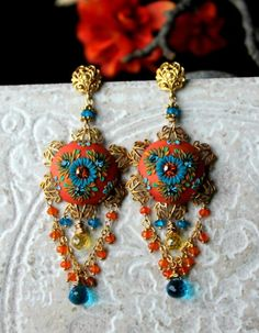 Peelirohini makes some very showy pieces using polymer embroidery, filigree pieces, and beads with lots of rich colors and contrast. As seen on The Polymer Arts magazine's blog.  www.thepolymerarts.com