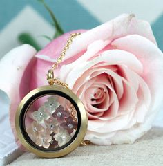 Want to have beautiful locket like this?  Visit www.southhilldesigns.com/calicocojewelry and click SHOP