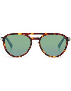 Tortoiseshell sunglasses with rounded green lenses