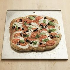 Fresh Tomato & Black Olive Pizza - EatingWell.com
