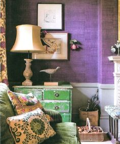 The white wainscoting dilutes the intense Radiant Orchid wallpaper for a palatable living room