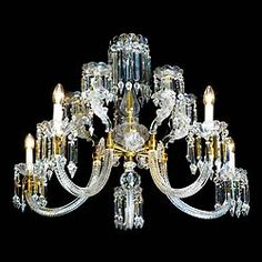 An impressive good quality 5 branch cut glass crystal Chandelier,each scrolling branch with large faceted pendants from the wax pans, further adorned with 5 frosted glass Putti Caryatids,one at the top of each branch.... in the English Neo Classical manner.Originally a 19th century gasolier now wired for electricity. Dated 1877.