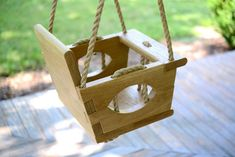Handmade Wood Toddler Swing - inspiration to make swing that uses no fasteners in it's construction but rather held together by the weaving in-and-out of the rope. thick white oak wood pieces & of rope Wooden Baby Swing, Wooden Swing Chair, Wood Swing, Swing Set Plans, Boat Plans, Diy Swing, Foto Baby, Backyard Playground, Baby Swings