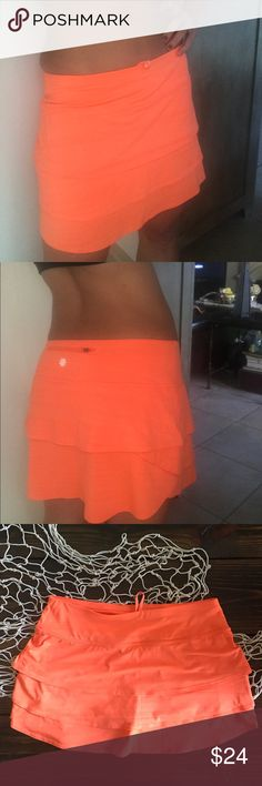 """Athletha Orange Sherbet Swagger workout skirt In excellent condition. It has been washed and hung to dry - never machine dried.   This is a size medium however you can not see the size as it has faded. The color of the skirt itself is perfect!!! Semi-fitted, Mid-rise Skims over the body for a just-right fit, sits two fingers below the navel Measurements: waist - 15.5"""" Hips - 20.5"""" Length - 13.5"""" C1 Athleta Shorts Skorts"""