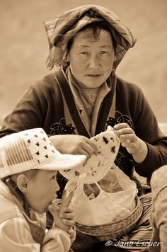 'Tibetan woman eating bread - Ganden, Tibet', photo Jano Escuer #bread #Tibet