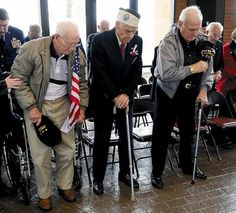 WWII - These men were already in the war before D-Day Commenced - Pearl Harbor survivors, from left, Bill Edwards, Ray Perlingiero and Durward Swanson stand during a moment of silence at a memorial service Monday at the Tennessee Veterans Cemetery.
