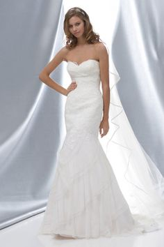 Trumpet / mermaid floor-length net bridal gown with appliques embellishment