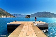 07-03 Lone female tourist standing on dock at Our Lady of the... #perast: 07-03 Lone female tourist standing on dock at Our Lady… #perast