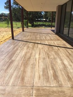 NOT real wood. It is polymer modified cement called THIN-FINISH™ applied to an existing concrete. Much more durable than real wood and never needs to be re-stained.