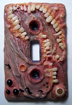 The Thing switch plate by Morgans Mutations on Etsy. This is soooo kewl but grosses me out a little.