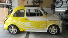 Old school Fiat 500 done in a creative yellow graphic design. Yes please!