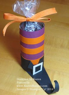 The Halloween Witch's Boot Candy Treat is made starting with a paper towel or toilet paper roll! #Halloweencandytreat
