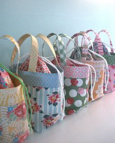 Lunch bags using 5 coordinating fat quarters - construction with small pieces makes this a great project for using scraps