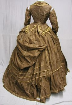 1870's Bustle Dress.  LOVE the bustle. Shame about the tears at the sleeve seams.