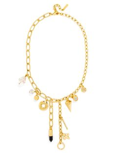 An oversized charm necklace with abstract charms is cool and blingy.
