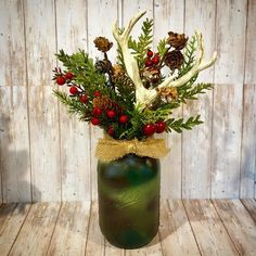 "Gloria Nutis on Instagram: ""A camouflage painted mason jar with antlers and holiday Floral is the perfect Christmas decor or host gift for the outdoor man in your…"""