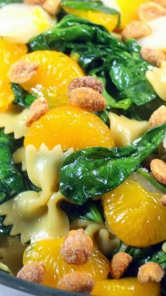 Orange-Teriyaki Spinach Pasta Salad  Beautiful mix of Colors, Textures and Tastes, Bright Oranges, Crunchy Water Chestnuts, healthy Earthy Spinach, Fresh Made Orange-Teriyaki Asian influenced Salad Dressing soaked Pasta and finally topped with the pop of Honey Roasted Peanuts!