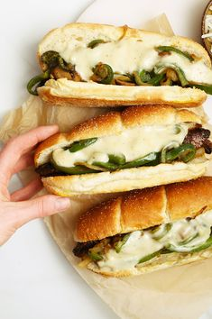 Vegan Philly Cheesesteaks made with marinated portobello mushrooms, sautéed onions and peppers, and homemade vegan cheese sauce for a healthier spin on this classic sandwich. #vegansandwich #mydarlingvegan