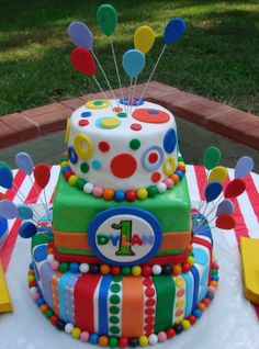 Carnival Birthday Cake - Covered in many colors of fondant circles and stripes