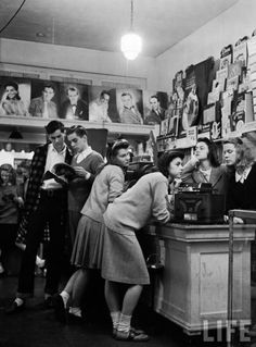 Group of teenagers listening to 45 rpm. records as they shop for the latest hits at a record store in West Grove, MS, 1944 #vintage #vinyl #lp #record #album