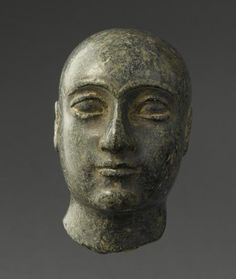 """This is a statue in the Louvre Museum (AO 4351). It's described simply as """"a man with a shaven head"""". It was found in the Sumerian city of Girsu, the holy city of the kingdom of Lagash,home of the E- ninnu,the Temple of the war god Ningirsu.The statue is dated in the period of Gudea,ca 2100 BCE"""